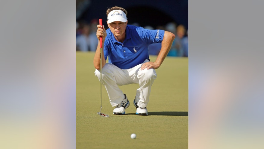 Davis Love III lines up a putt on the 18th hole during the final round of the Wyndham Championship golf tournament at Sedgefield Country Club in Greensboro, N.C., Sunday, Aug. 23, 2015. Love won the tournament. (AP Photo/Chuck Burton)