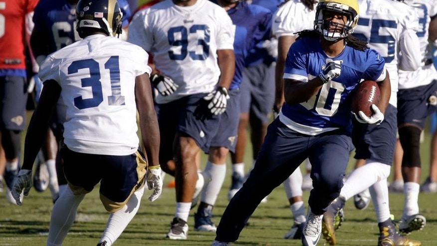 St. Louis Rams running back Todd Gurley, right, runs with the ball as safety Maurice Alexander (31) defends during training camp at the NFL football team's practice facility Tuesday, Aug. 25, 2015, in St. Louis. Gurley, who is rehabbing from left knee surgery that ended his college career, has been cleared to practice, but the 10th overall pick in the draft still won't play in the preseason. (AP Photo/Jeff Roberson)