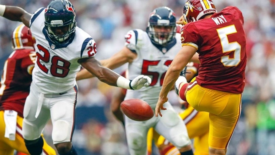 Sep 7, 2014; Houston, TX, USA; Houston Texans running back Alfred Blue (28) blocks the punt of Washington Redskins punter Tress Way (5) and scores a touchdown during the first half at NRG Stadium. Mandatory Credit: Kevin Jairaj-USA TODAY Sports