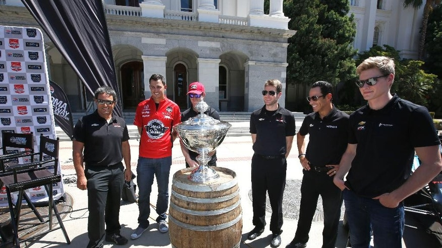 Indy Car drivers, from left to right, Juan Pablo Montoya, Graham Rahal, Scott Dixon, Will Power, Helio Castroneves and Josef Newgarden pose around the Astor Cup after a news conference about the weekend's Go Pro Grand Prix of Sonoma auto race Wednesday, Aug. 26, 2015, held a the Capitol in Sacramento,Calif. The Astor Cup is awarded to the points winner of the IndyCar Championship. (AP Photo/Rich Pedroncelli)
