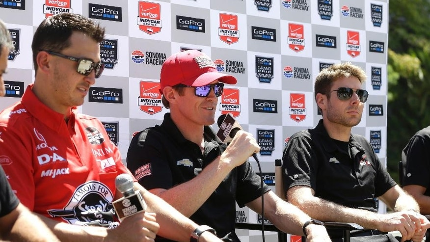 Scott Dixon, of Target Chip Ganassi Racing, talks about the recent death of driver Justin Wilson, during a news conference about the weekend's Go Pro Grand Prix of Sonoma auto race at the state Capitol, Wednesday, Aug. 26, 2015, in Sacramento, Calif. Drivers Graham Rahal, left, of Rahal Letterman Lanigan Racing, and Will Power, right, of Team Penske, look on. (AP Photo/Rich Pedroncelli)
