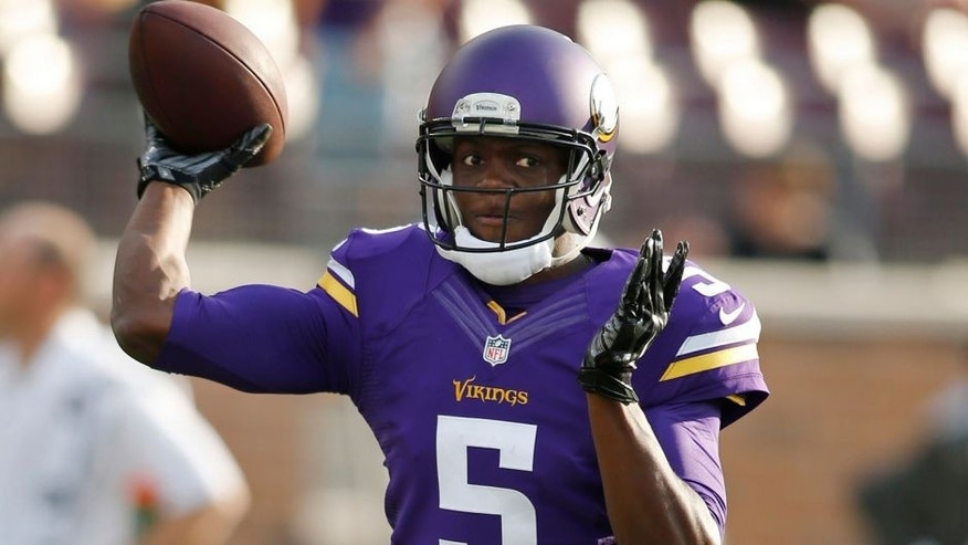 <p>Aug 8, 2014; Minneapolis, MN, USA; Minnesota Vikings quarterback Teddy Bridgewater (5) passes before the game against the Oakland Raiders at TCF Bank Stadium. Mandatory Credit: Bruce Kluckhohn-USA TODAY Sports</p>