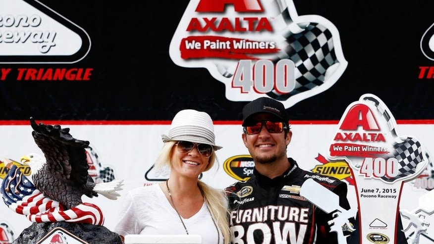 LONG POND, PA - JUNE 07: Martin Truex Jr., driver of the #78 Furniture Row/Visser Precision Chevrolet, right, and his girlfriend, Sherry Pollex, pose in Victory Lane after Truex Jr. won the NASCAR Sprint Cup Series Axalta 'We Paint Winners' 400 at Pocono Raceway on June 7, 2015 in Long Pond, Pennsylvania. (Photo by Jeff Zelevansky/NASCAR via Getty Images)