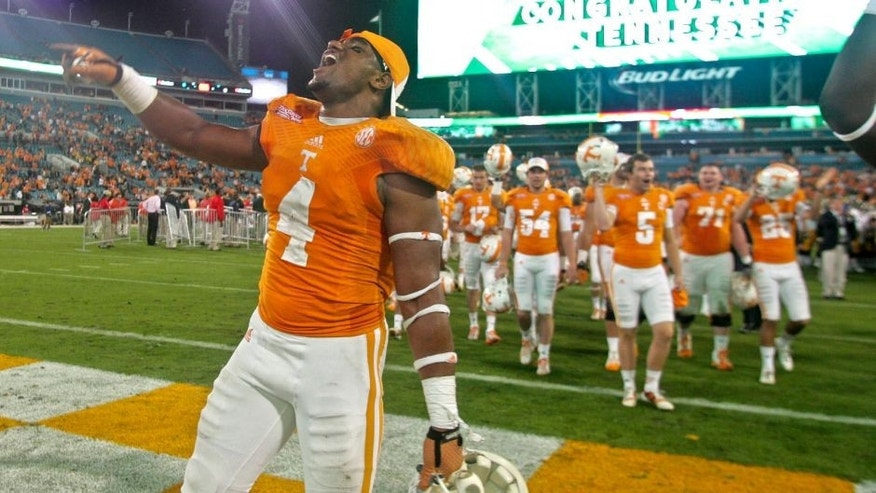 Jan 2, 2015; Jacksonville, FL, USA; Tennessee Volunteers defensive lineman LaTroy Lewis (4) celebrates after their 2015 TaxSlayer Bowl game against the Iowa Hawkeyes at EverBank Field. The Tennessee Volunteers beat the Iowa Hawkeyes 45-28. Mandatory Credit: Phil Sears-USA TODAY Sports