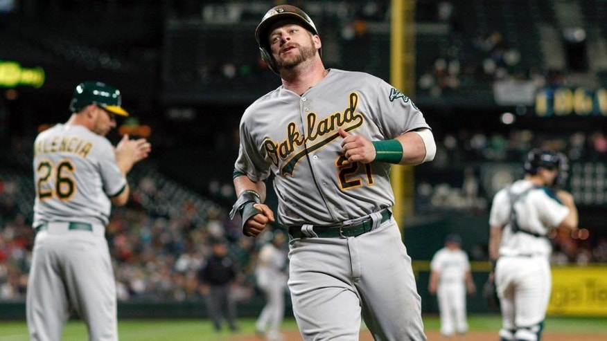 SEATTLE, WA - AUGUST 24: Stephen Vogt #21 of the Oakland Athletics heads to the dugout after scoring in the ninth inning against the Seattle Mariners at Safeco Field on August 24, 2015 in Seattle, Washington. (Photo by Otto Greule Jr/Getty Images)