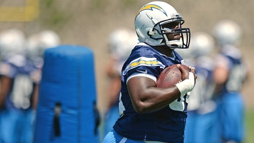 Jun 16, 2015; San Diego, CA, USA; San Diego Chargers defensive end Corey Liuget (94) participates in a drill during minicamp at Charger Park. Mandatory Credit: Jake Roth-USA TODAY Sports