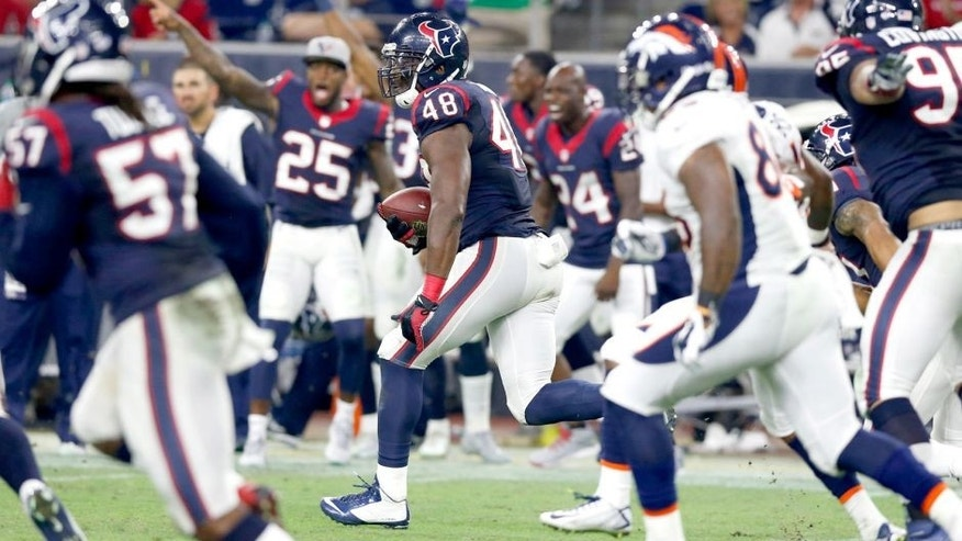 Aug 22, 2015; Houston, TX, USA; Houston Texans linebacker Kourtnei Brown (48) runs back an interception for a touchdown against the Denver Broncos at NRG Stadium. The Broncos beat the Texans 14-10. Mandatory Credit: Matthew Emmons-USA TODAY Sports