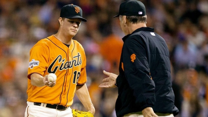 SAN FRANCISCO, CA - AUGUST 14: Matt Cain #18 of the San Francisco Giants is relieved by manager Bruce Bochy #15 during the fifth inning against the Washington Nationals at AT&T Park on August 14, 2015 in San Francisco, California. The San Francisco Giants defeated the Washington Nationals 8-5. (Photo by Jason O. Watson/Getty Images)