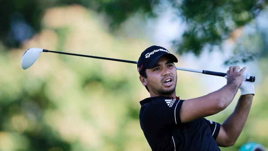 Jason Day, left, of Australia, reacts to his tee shot on the 11th hole during the first round of play at The Barclays golf tournament Thursday, Aug. 27, 2015, in Edison, N.J. (AP Photo/Mel Evans)