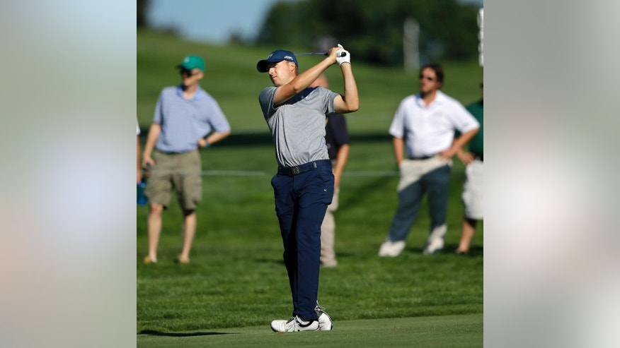 Jordan Spieth hits a fairway shot on the 12th hole during the first round of play at The Barclays golf tournament Thursday, Aug. 27, 2015, in Edison, N.J. (AP Photo/Mel Evans)
