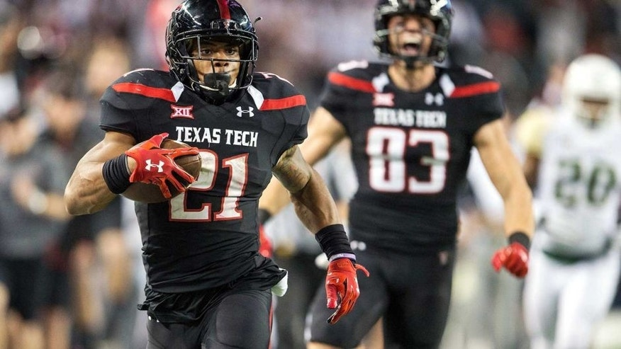 Nov 29, 2014; Arlington, TX, USA; Texas Tech Red Raiders running back DeAndre Washington (21) runs for a touchdown against the Baylor Bears during the second half at AT&T Stadium. The Bears defeated the Red Raiders 48-46. Mandatory Credit: Jerome Miron-USA TODAY Sports