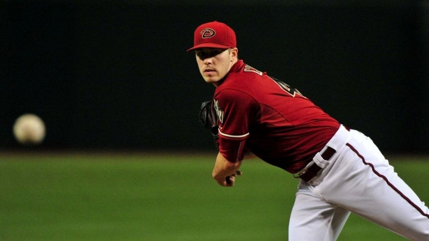 Aug 26, 2015; Phoenix, AZ, USA; Arizona Diamondbacks starting pitcher Patrick Corbin (46) throws during the first inning against the St. Louis Cardinals at Chase Field. Mandatory Credit: Matt Kartozian-USA TODAY Sports