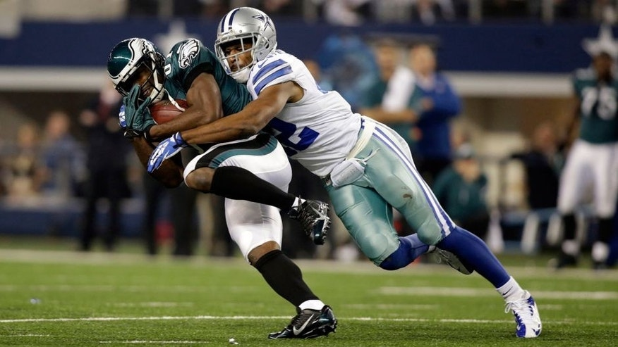 Dec 29, 2013; Arlington, TX, USA; Philadelphia Eagles wide receiver Jason Avant (81) is tackled by Dallas Cowboys free safety Barry Church (42) in the second quarter at AT&T Stadium. Mandatory Credit: Tim Heitman-USA TODAY Sports