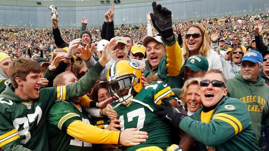 Sunday, October 19: The Green Bay Packers' Davante Adams celebrates his touchdown catch with fans during the second half against the Carolina Panthers.