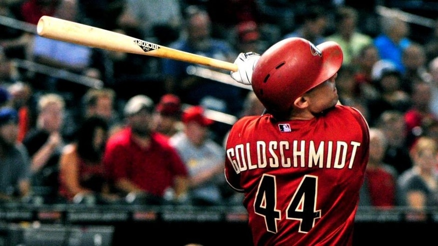 Aug 26, 2015; Phoenix, AZ, USA; Arizona Diamondbacks first baseman Paul Goldschmidt (44) hits a solo home run during the first inning against the St. Louis Cardinals at Chase Field. Mandatory Credit: Matt Kartozian-USA TODAY Sports