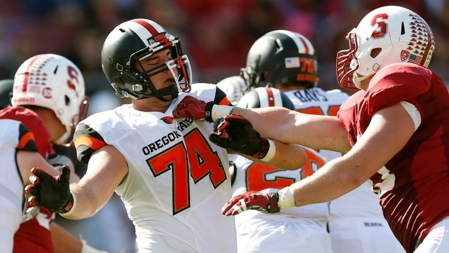 Oct 25, 2014; Stanford, CA, USA; Oregon State Beavers offensive lineman Dustin Stanton (74) blocks Stanford Cardinal linebacker Kevin Anderson (48) during the second half at Stanford Stadium. Stanford won 38-14. Mandatory Credit: Bob Stanton-USA TODAY Sports