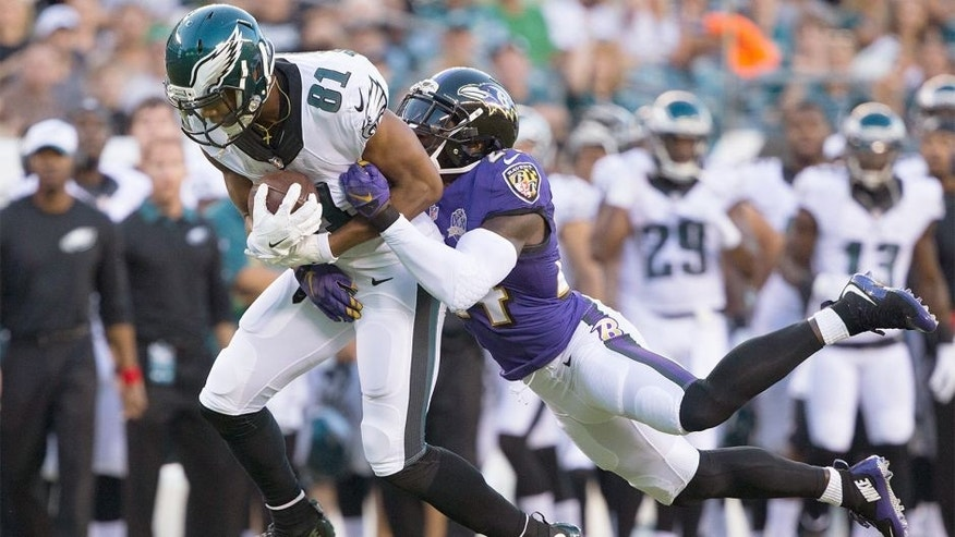 Aug 22, 2015; Philadelphia, PA, USA; Philadelphia Eagles wide receiver Jordan Matthews (81) catches the ball in front of the defense of Baltimore Ravens defensive back Kyle Arrington (24) at Lincoln Financial Field. Mandatory Credit: Bill Streicher-USA TODAY Sports