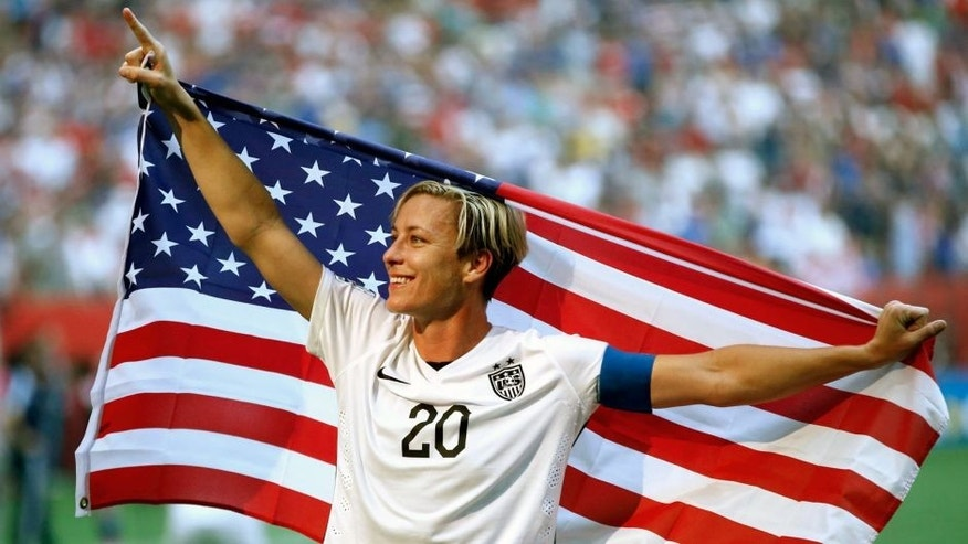 Jul 5, 2015; Vancouver, British Columbia, CAN; United States forward Abby Wambach (20) celebrates after defeating Japan in the final of the FIFA 2015 Women's World Cup at BC Place Stadium. United States won 5-2. Mandatory Credit: Michael Chow-USA TODAY Sports