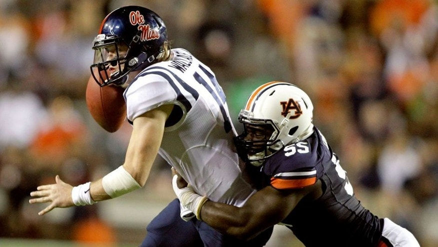 Oct 5, 2013; Auburn, AL, USA; Mississippi Rebels quarterback Bo Wallace (14) is tackled by Auburn Tigers defensive end Carl Lawson (55) during the first half at Jordan Hare Stadium. Mandatory Credit: John Reed-USA TODAY Sports