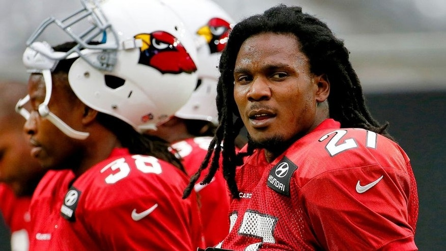 Arizona Cardinals running back Chris Johnson participates in an NFL football training camp, Tuesday, Aug. 18, 2015, in Glendale, Ariz. (AP Photo/Matt York)