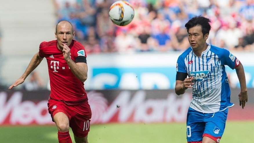 Kim Jin-su of Hoffenheim, right, challenges for the ball with Munich's Arjen Robben during the Germany Soccer Bundesliga match between TSG Hoffenheim and Bayern Munich in Sinsheim, southern Germany, Saturday Aug. 22, 2015. (AP Photo/Daniel Maurer)