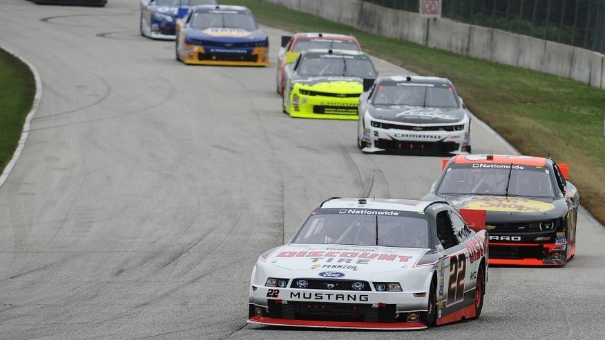 ELKHART LAKE, W.I. - JUNE 21: Alex Tagliani, driver of the #22 Discount Tire Ford, leads a pack of cars during the NASCAR Nationwide Series Gardner Denver 200 Fired Up by Johnsonville at Road America, June 21, 2014 in Elkhart Lake, Wisconsin. (Photo by Rainier Ehrhardt/Getty Images)