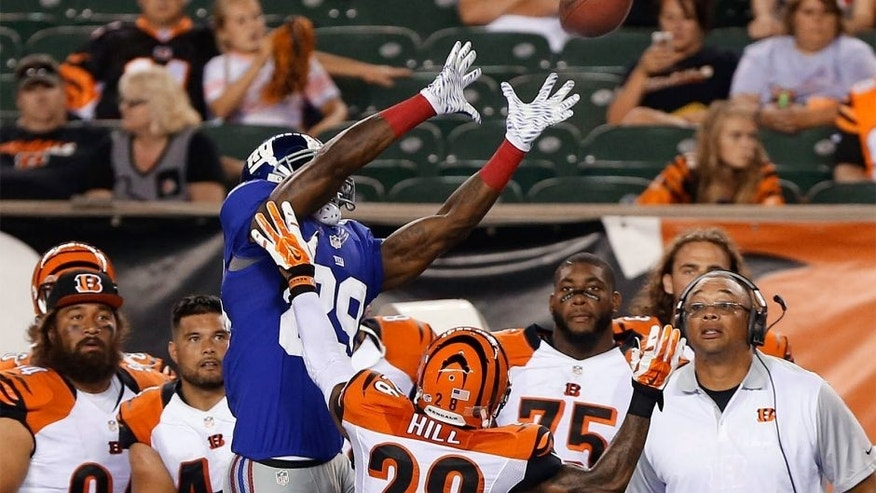 Aug 14, 2015; Cincinnati, OH, USA; New York Giants strong safety Nat Berhe (29) attempts a catch over Cincinnati Bengals cornerback Troy Hill (28) in the second half in a preseason NFL football game at Paul Brown Stadium. The Bengals won 23-10. Mandatory Credit: Aaron Doster-USA TODAY Sports
