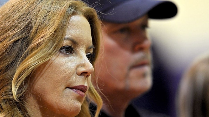 August 10, 2012; El Segundo, CA, USA; Los Angeles Lakers Jeanie Buss and Jim Buss during a press conference held to introduce the three-time defensive player of the year who was aquired in a four-team trade from the Orlando Magic, Los Angeles Lakers center Dwight Howard. Mandatory Credit: Jayne Kamin-Oncea-USA TODAY Sports