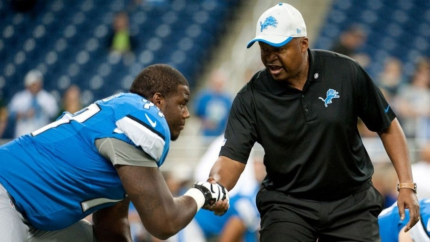 Sep 21, 2014; Detroit, MI, USA; Detroit Lions head coach Jim Caldwell shacks hands with tackle Cornelius Lucas (77) before the game against the Green Bay Packers at Ford Field. Mandatory Credit: Tim Fuller-USA TODAY Sports
