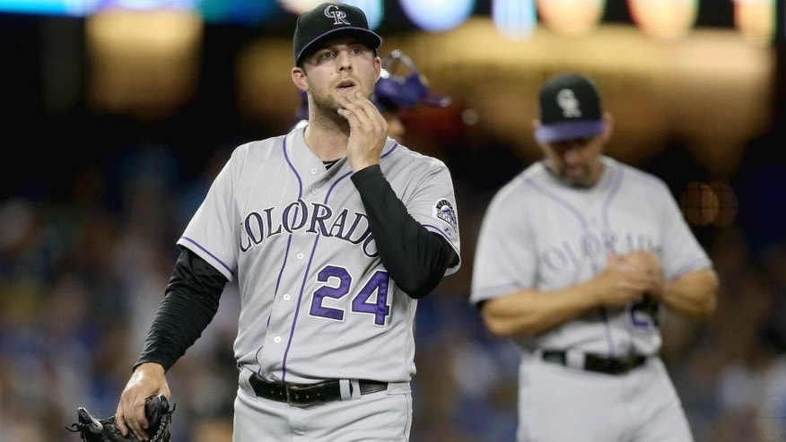 LOS ANGELES, CA - SEPTEMBER 26: Starting pitcher Jordan Lyles #24 of the Colorado Rockies comes out of the game in the sixth inning against the Los Angeles Dodgers at Dodger Stadium on September 26, 2014 in Los Angeles, California. (Photo by Jeff Gross/Getty Images)