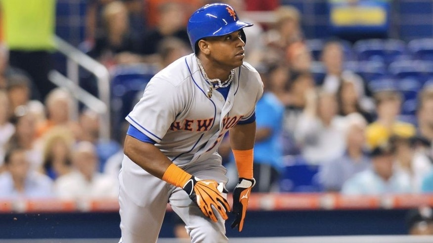 Aug 3, 2015; Miami, FL, USA; New York Mets center fielder Yoenis Cespedes (52) connects for an two run RBI double during the fifth inning against the Miami Marlins at Marlins Park. Mandatory Credit: Steve Mitchell-USA TODAY Sports