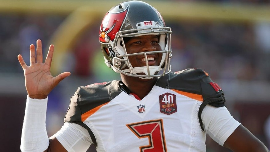<p>Tampa Bay Buccaneers quarterback Jameis Winston waves as players warm up for a preseason NFL football game against the Minnesota Vikings on Saturday, Aug. 15, 2015, in Minneapolis. (AP Photo/Jim Mone)</p>