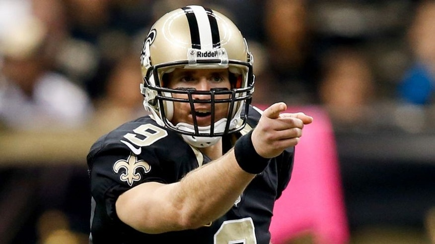 Dec 29, 2013; New Orleans, LA, USA; New Orleans Saints quarterback Drew Brees (9) against the Tampa Bay Buccaneers during the first quarter of a game at the Mercedes-Benz Superdome. Mandatory Credit: Derick E. Hingle-USA TODAY Sports