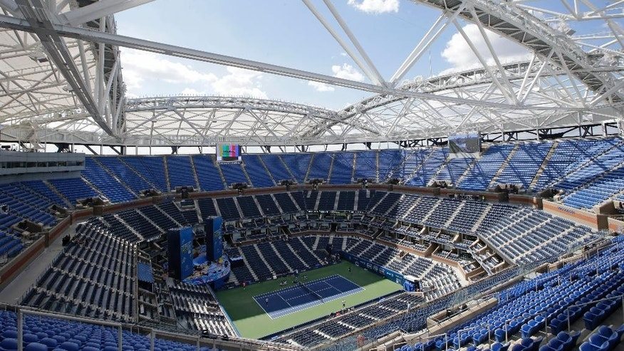 A view from the upper seating section in Arthur Ashe Stadium shows the framework of a retractable roof over the main court at the USTA Billie Jean King National Tennis Center in New York, Thursday, Aug. 27, 2015, home to the U.S. Open tennis tournament. Although rain delays could still plague this year's U.S. Open, fans will be able to watch matches from beneath the shade the roof provides. (AP Photo/Kathy Willens)