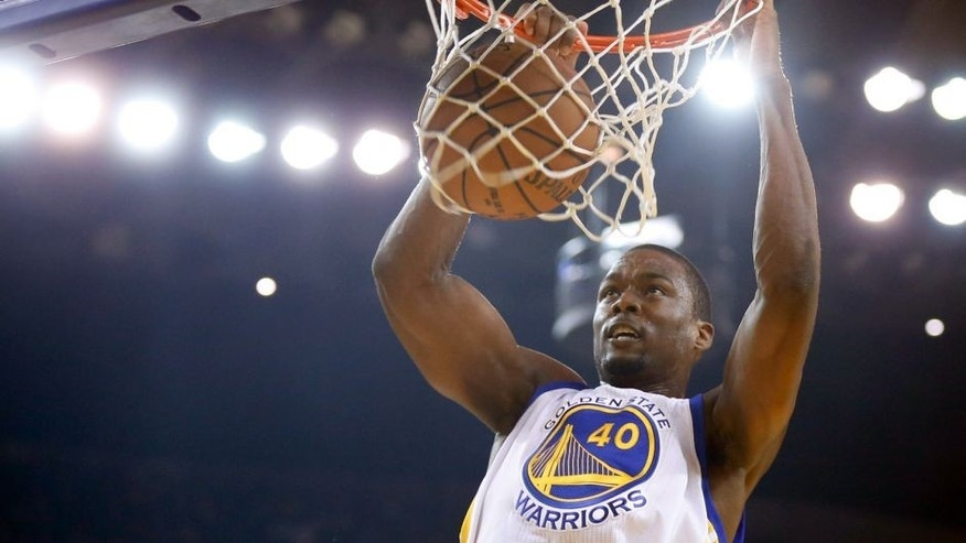 Dec 4, 2014; Oakland, CA, USA; Golden State Warriors forward Harrison Barnes (40) dunks the ball against the New Orleans Pelicans during the first quarter at Oracle Arena. Mandatory Credit: Kelley L Cox-USA TODAY Sports