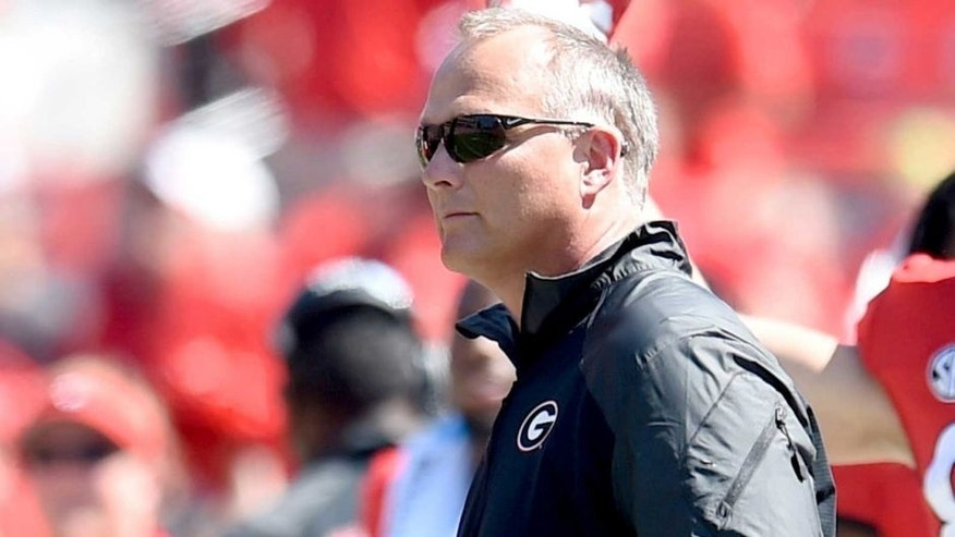 Sep 20, 2014; Athens, GA, USA; Georgia Bulldogs head coach Mark Richt coaches against the Troy Trojans during the second half at Sanford Stadium. Georgia defeated Troy 66-0. Mandatory Credit: Dale Zanine-USA TODAY Sports