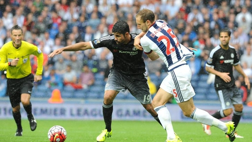 Chelsea's Diego Costa, left, and West Brom's Craig Dawson contest the ball during the English Premier League soccer match between West Bromwich Albion and Chelsea at the Hawthorns, West Bromwich, England, Sunday, Aug. 23, 2015. (AP Photo/Rui Vieira)