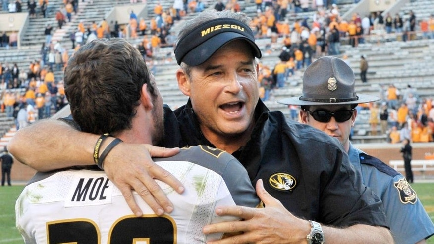 Nov 10, 2012; Knoxville, TN, USA; Missouri Tigers head coach Gary Pinkel celebrates with Missouri wide receiver T.J. Moe (28) after defeating the Tennessee Volunteers 51-48 in quadruple overtime at Neyland Stadium. Missouri defeated Tennessee . Mandatory Credit: Jim Brown-USA TODAY Sports