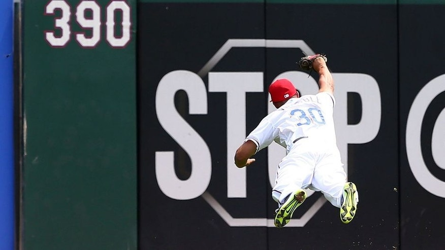 ARLINGTON, TX - AUGUST 27: Will Venable #30 of the Texas Rangers makes a diving catch in the second inning during a game against the Toronto Blue Jays at Globe Life Park in Arlington on August 27, 2015 in Arlington, Texas. (Photo by Sarah Crabill/Getty Images)