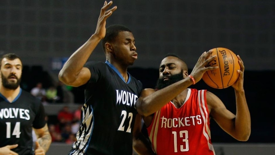 <p>Houston Rockets' James Harden (13), right, dives to the basket as Minnesota Timberwolves' Andrew Wiggins (22) defends during the first half of an NBA basketball game in Mexico City, Wednesday, Nov. 12, 2014. (AP Photo/Eduardo Verdugo)</p>