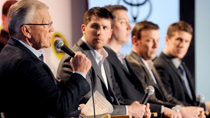 CHARLOTTE, NC - JANUARY 26: Joe Gibbs (left), owner of Joe Gibbs Racing, speaks with the media during the NASCAR Sprint Media Tour at the Charlotte Convention Center on January 26, 2015 in Charlotte, North Carolina. (Photo by Jared C. Tilton/NASCAR via Getty Images)