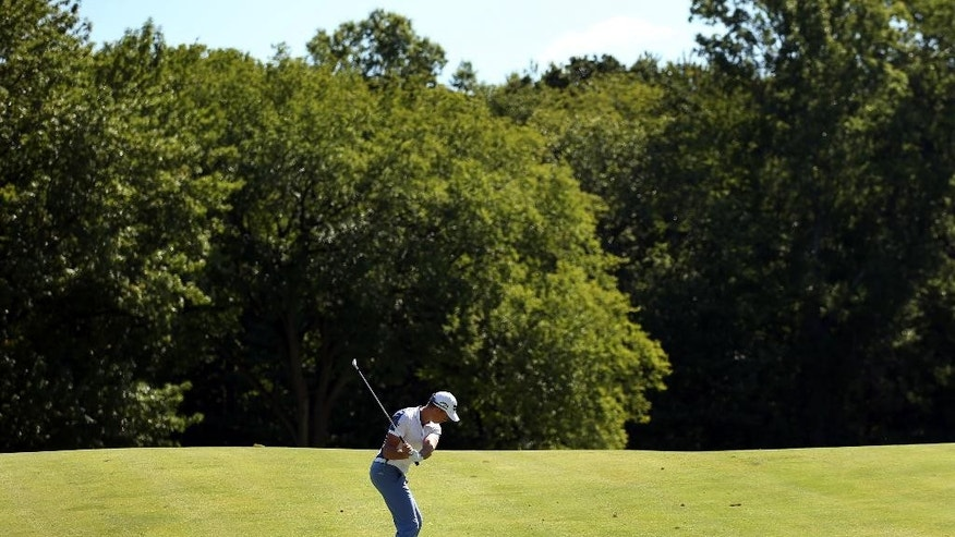 Henrik Stenson, of Sweden, hits from the 13th fairway during the second round of play at The Barclays golf tournament Friday, Aug. 28, 2015, in Edison, N.J. (AP Photo/Adam Hunger)