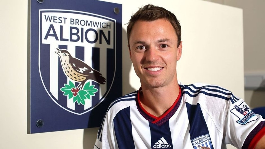 WALSALL, ENGLAND - AUGUST 28: West Bromwich Albion unveil new signing Jonny Evans from Manchester Untied at West Bromwich Albion Training Ground on August 28, 2015 in Walsall, England. (Photo by Matthew Ashton - AMA/Getty Images)