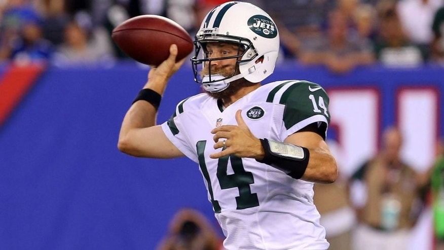 Aug 29, 2015; East Rutherford, NJ, USA; New York Jets quarterback Ryan Fitzpatrick (14) throws a pass during the first half of their game against the New York Giants at MetLife Stadium. Mandatory Credit: Ed Mulholland-USA TODAY Sports