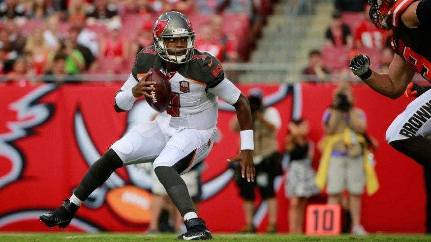 Aug 29, 2015; Tampa, FL, USA; Tampa Bay Buccaneers quarterback Jameis Winston (3) gets pressured against the Cleveland Browns during the first quarter at Raymond James Stadium. Mandatory Credit: Kim Klement-USA TODAY Sports