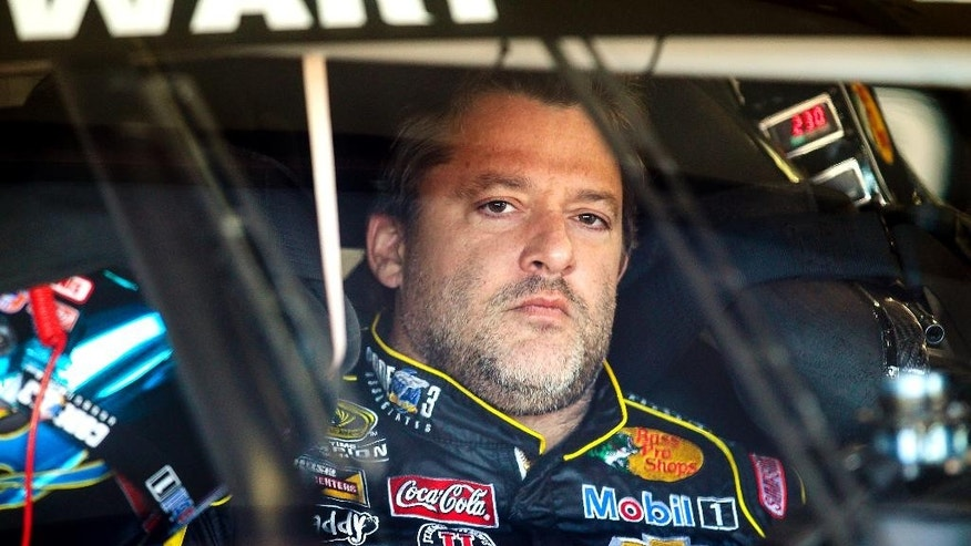 FILE - In this Sept. 19, 2014, file photo, Tony Stewart sits in his car during practice for the NASCAR Sprint Cup auto race at New Hampshire Motor Speedway in Loudon, N.H. Stewart says in court papers filed Friday, Aug. 28, 2015, that he didn't see fellow driver Kevin Ward Jr. walking along the track before striking and killing him during a dirt track race at Canandaigua Motorsports Park on Aug. 9, 2014. (AP Photo/Cheryl Senter, File)