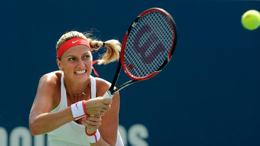 Petra Kvitova, of the Czech Republic, hits a backhand against Lucie Safarova, also of the Czech Republic, during the finals of the Connecticut Open tennis tournament in New Haven, Conn., on Saturday, Aug. 29, 2015. (AP Photo/Fred Beckham)