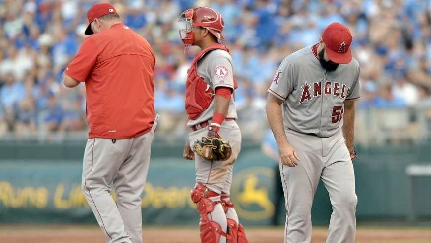 Aug 15, 2015; Kansas City, MO, USA; Los Angeles Angels manager Mike Scioscia (14) comes to the mound to relieve starting pitcher Matt Shoemaker (52) in the second inning against the Kansas City Royals at Kauffman Stadium. Mandatory Credit: Denny Medley-USA TODAY Sports