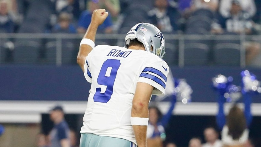 Dallas Cowboys quarterback Tony Romo (9) celebrates his touchdown pass against the Minnesota Vikings during the first half of a preseason NFL football game Saturday, Aug. 29, 2015, in Arlington, Texas. (AP Photo/Tony Gutierrez)