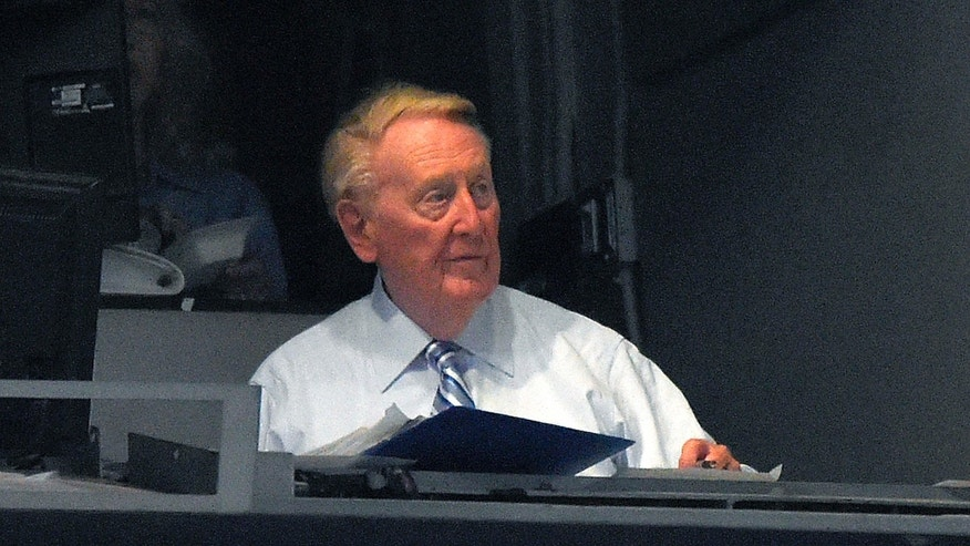 Aug. 28, 2015: Los Angeles Dodgers Hall of Fame announcer Vin Scully sits in his booth during the third inning of a baseball game between the Dodgers and the Chicago Cubs.
